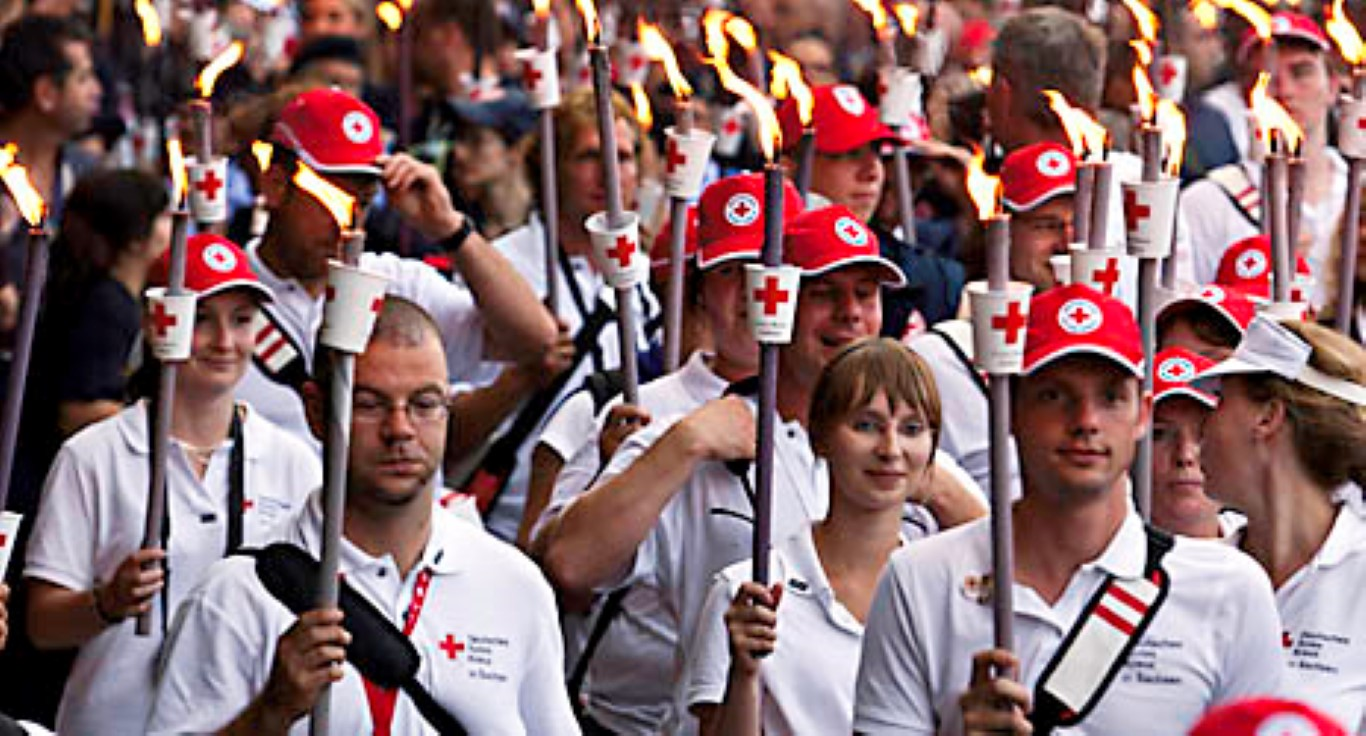 From the town of Solferino an estimated 13,000 members of the Red Cross Red Crescent Movement embark on a     8.6 kilometer torch-lit procession called the fiaccolta to celebrate the 150th anniversary of the Red Cross Red Crescent Movement.